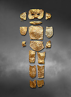 Body shaped Mycenaean gold cut outs from Grave III, 'Grave of a Women', Grave Circle A, Myenae, Greece. National Archaeological Museum Athens. Grey art Background <br /> <br /> Cat No 146. 16th century BC.<br /> <br /> A unique gold body covering and face of an infant child mad out of pieces of gold foll<br /> <br /> Shaft Grave III, the so-called 'Grave of the Women,' contained three female and two infant interments. The women were literally covered in gold jewelry and wore massive gold diadems, while the infants were overlaid with gold foil.
