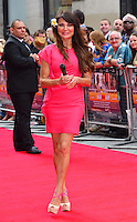 Lizzie Cundy<br /> The &quot;Bula Quo!&quot; UK film premiere, Odeon West End cinema, Leicester Square, London, England.<br /> July 1st, 2013<br /> full length pink flower in hair<br /> CAP/BF<br /> &copy;Bob Fidgeon/Capital Pictures