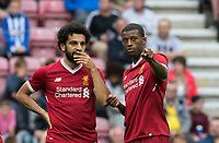 Georginio Wijnaldum chats to new signing Mohamed Salah of Liverpool during the pre season friendly match between Wigan Athletic and Liverpool at the DW Stadium, Wigan, England on 14 July 2017. Photo by Andy Rowland.