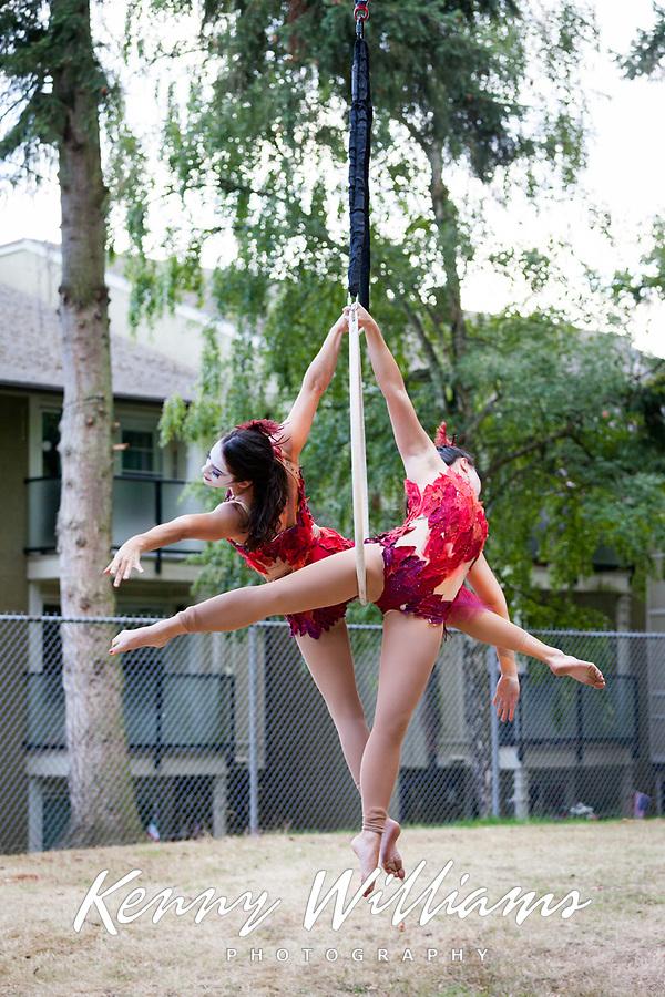 Sanca Women Acrobatics Suspended on Ring, Arts-A-Glow Festival, Dottie Harper Park, Burien, WA, USA.