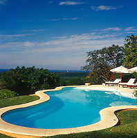The swimming pool, like the terraces, is located at the rear of the property affording views over the surrounding countryside and the Pacific Ocean beyond