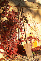 A spade in the garden at Chateau Belingard in autumn evening sunshine Chateau Belingard Bergerac Dordogne France
