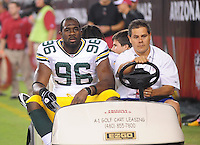 Aug. 28, 2009; Glendale, AZ, USA; Green Bay Packers defensive end (96) Michael Montgomery is carted off the field after suffering an injury against the Arizona Cardinals during a preseason game at University of Phoenix Stadium. Mandatory Credit: Mark J. Rebilas-