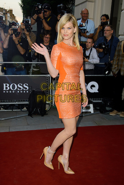 Alice Eve<br /> GQ Men of the Year Awards 2013 at the Royal Opera House, London, England.<br /> September 3rd, 2013<br /> full length orange dress side hand arm waving <br /> CAP/CJ<br /> &copy;Chris Joseph/Capital Pictures