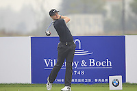 Oliver Fisher (ENG) tees off the 15th tee during Friday's Round 2 of the 2014 BMW Masters held at Lake Malaren, Shanghai, China 31st October 2014.<br /> Picture: Eoin Clarke www.golffile.ie