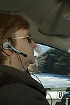 Woman using cell phone headset while driving