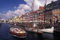 Copenhagen, Denmark, Scandinavia, Sjaelland, canal, Europe, Tour boat cruises Nyhavn (New Harbor) along the scenic city of Copenhagen