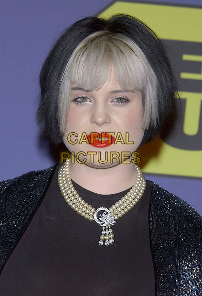 "KELLY OSBOURNE.Best Buy Hosts Elton John ""Dream Ticket"" Launch held at Caesar's Palace, Las Vegas, Nevada, USA, .24th October 2004..portrait headshot white fringe black hair red lipstick pearls necklace.**UK SALES ONLY**.Ref: ADM.www.capitalpictures.com.sales@capitalpictures.com.©VS/AdMedia/Capital Pictures ."