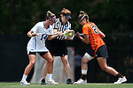 16 May 2015: Duke's Taylor Trimble (14) and Princeton's Erin McMunn (20) take a faceoff from official Liz Brush. The Duke University Blue Devils hosted the Princeton University Tigers at Koskinen Stadium in Durham, North Carolina in a 2015 NCAA Division I Women's Lacrosse Tournament quarterfinal match. Duke won the game 7-3.