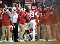 NWA Democrat-Gazette/CHARLIE KAIJO Arkansas teammates congratulate quarterback K.J. Jefferson (13) after a score, Saturday, November 2, 2019 during the fourth quarter of a football game at Donald W. Reynolds Razorback Stadium in Fayetteville. Visit nwadg.com/photos to see more photographs from the game.