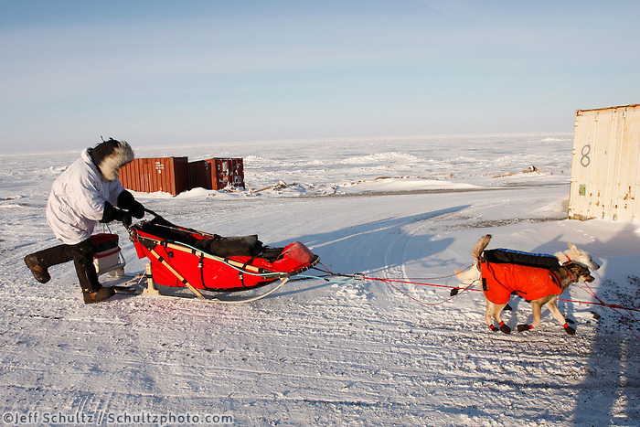 Monday  March 15 , 2010  Paul Gebhart crosses a road after leaving Unalakleet shortly after sunrise