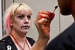 27 MAY 2011 - PHOENIX, AZ: GINGER MORTIS makes up zombies before the Zombie Walk at Phoenix Comicon Friday. Phoenix Comicon opened Thursday and featured a Zombie Walk through downtown Phoenix Friday night. Hundreds of people participated in the Zombie Walk, both as Zombies and as Zombie hunters. This year's Comicon includes appearances by Leonard Nimoy (Star Trek), Adam Baldwin (Firefly and Chuck), Stan Lee (Marvel Comics), Nicholas Brendon (Buffy the Vampire Slayer) and others. Activities include costuming workshops, role playing games and a Geek Prom.     Photo by Jack Kurtz