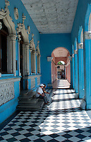 Palmira Cuba old building with blue pillars and black and white checkered tile floor with couple   10