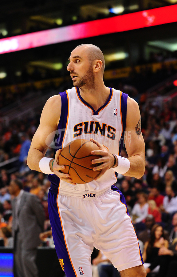 Jan. 26, 2011; Phoenix, AZ, USA; Phoenix Suns Marcin Gortat against the Charlotte Bobcats at the US Airways Center. The Bobcats defeated the Suns 114-107. Mandatory Credit: Mark J. Rebilas-
