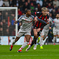 Liverpool's Georginio Wijnaldum (left) battles with \Bournemouth's David Brooks (right) <br /> <br /> Photographer David Horton/CameraSport<br /> <br /> The Premier League - Bournemouth v Liverpool - Saturday 8th December 2018 - Vitality Stadium - Bournemouth<br /> <br /> World Copyright © 2018 CameraSport. All rights reserved. 43 Linden Ave. Countesthorpe. Leicester. England. LE8 5PG - Tel: +44 (0) 116 277 4147 - admin@camerasport.com - www.camerasport.com