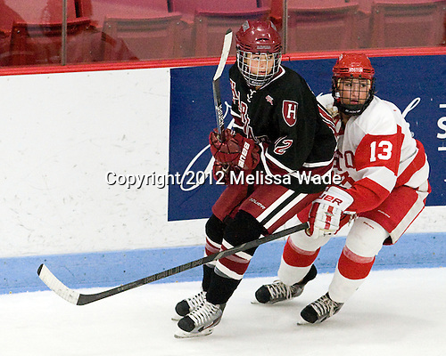 Samantha Reber (Harvard - 12), Kaleigh Fratkin (BU - 13) - The Boston University Terriers defeated the visiting Harvard University Crimson 2-1 on Sunday, November 18, 2012, at Walter Brown Arena in Boston, Massachusetts.