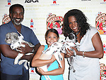 Norm Lewis, Audra McDonald & daughter Zoe Madeline  (Porgy and Bess).backstage at Broadway Barks 14 at the Booth Theatre on July 14, 2012 in New York City. Marking its 14th anniversary, Broadway Barks!, founded by Bernadette Peters and Mary Tyler Moore helps many of New York City's shelter animals find permanent homes and also inform New Yorkers about the plight of the thousands of homeless dogs and cats in the metropolitan area.