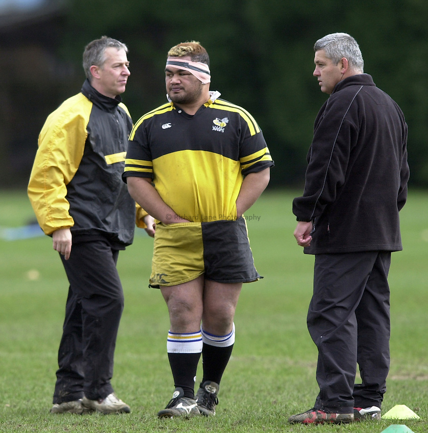 Picture : Greig Cowie.06/02/2002.Wasps Training Session..Twyford Avenue Training Ground. Acton..Trevor Leota has his hands in his pants as Warren Gatland and Nigel Melville look on..