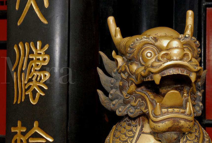Statue of mythical beast guarding a shrine at the Buddhist Wenshu Temple, Chengdu, China.
