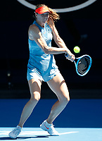 14th January 2019, Melbourne Park, Melbourne, Australia; Australian Open Tennis, day 1; <br /> Maria Sharapova of Russia returns the ball in the match against Harriet Dart of Great Britain