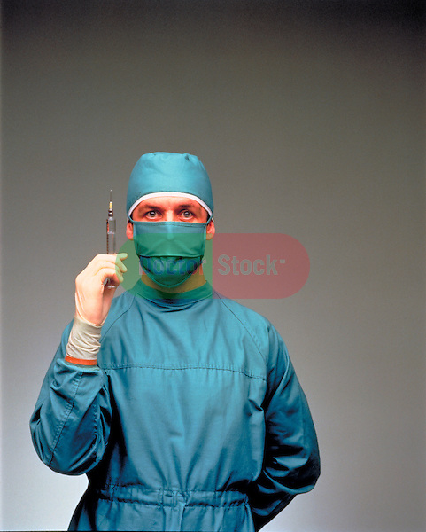 Anesthesiologist in surgical scrub outfit with syringe