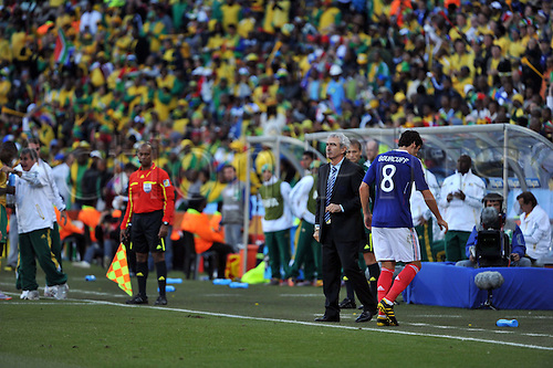 (L-R) Raymond Domenech, Yoann Gourcuff (FRA), JUNE 22, 2010 - Football : Yoann Gourcuff of France walks past head coach Raymond Domenech after being sent off during the 2010 FIFA World Cup South Africa Group A match between France 1-2 South Africa at Free State Stadium in Bloemfontein, South Africa.