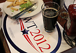 Supporters of Republican presidential candidate Newt Gingrich have lunch while waiting for his campaign stop at the Great Basin Brewing Company in Reno, Nev., on Wednesday, Feb. 1, 2012..Photo by Cathleen Allison