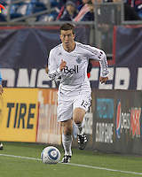 Vancouver Whitecaps FC midfielder Jeb Brovsky (12) brings the ball forward. In a Major League Soccer (MLS) match, the New England Revolution defeated the Vancouver Whitecaps FC, 1-0, at Gillette Stadium on May14, 2011.