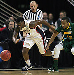 Gonzaga's Gary Bell (5) heads towards the basket after stealing the ball from North Dakota State's Lawrence Alexander (12) during the 2015 NCAA Division I Men's Basketball Championship's March 20, 2015 at the Key Arena in Seattle, Washington.©2015. Jim Bryant Photo. ALL RIGHTS RESERVED.