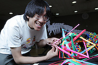 New York, NY, USA - June 24, 2011: Daniel Kwan, Origami designer and folder at the OrigamiUSA Convention in New York City, assembling one of his modular creations.