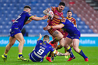 Picture by Alex Whitehead/SWpix.com - 08/02/2018 - Rugby League - Betfred Super League - Huddersfield Giants v Warrington Wolves - John Smith's Stadium, Huddersfield, England - Huddersfield's Oliver Roberts is tackled by Warrington's Joe Philbin, Daryl Clark and Chris Hill.