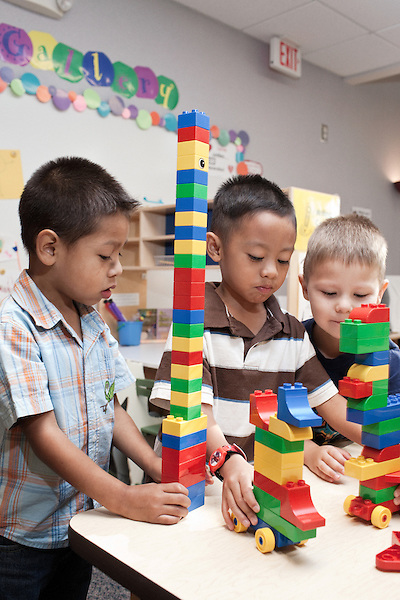 September 14, 2011. Raleigh, NC. . (left to right) Alfredo Benitez, Gian David De La Rosa, and Tyler Roth work with legos. . Project Enlightenment, a public pre-kindergarten program for at risk children, has been threatened with closure due to state wide budget cuts..