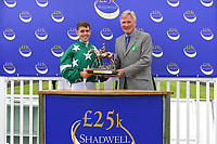 Jockey Oliver Searle receives his trophy for winning The Shadwell Racing Excellence Apprentice Series 2019  during Racing at Salisbury Racecourse on 5th September 2019