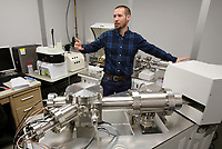 NWA Democrat-Gazette/DAVID GOTTSCHALK John Samuelsen, an anthropology doctoral candidate and Arkansas Archeological Survey staff member, describes Thursday, April 19, 2018, the multicollector inductively coupled plasma mass spectrometer inside the Daniel E. Ferritor Hall on the campus of the University of Arkansas in Fayetteville. Samuelsen's has received a grant to study lead and strontium isotopes in the remains of a skull-and-mandible cemetery at the Crenshaw site in southwest Arkansas.