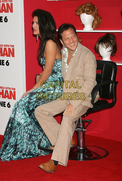 "NATALIA GUSLISTAYA & ROB SCHNEIDER.""You Don't Mess With The Zohan"" LA Premiere at Grauman's Chinese Theatre, Hollywood, California, USA,.28 May 2008..full length  blue green print maxi long dress black turquoise sitting in chair brown suit.CAP/ADM/MJ.©Michael Jade/Admedia/Capital Pictures"