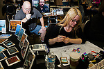 Artist examines a rare card. <br /> <br /> <br /> Magic The Gathering Grand Prix, Washington DC. <br /> <br /> Danny Ghitis for Bloomberg Businessweek