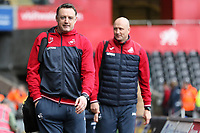 (L-R) Goalkeeping coach Tony Roberts and Swansea City assistant manager Cameron Toshack arrive prior to the game during the Premier League match between Swansea City and Crystal Palace at The Liberty Stadium, Swansea, Wales, UK. Saturday 23 December 2017