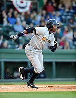 Outfielder Yeicok Calderon (25) of the Charleston RiverDogs in a game against the Greenville Drive on Opening Day, Friday, April 5, 2013, at Fluor Field at the West End in Greenville, South Carolina. (Tom Priddy/Four Seam Images)