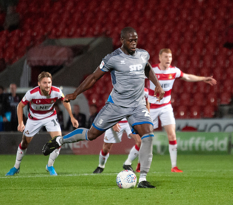 Lincoln City's John Akinde strikes a penalty to see it saved by Doncaster Rovers' Seny Dieng<br /> <br /> Photographer Andrew Vaughan/CameraSport<br /> <br /> EFL Leasing.com Trophy - Northern Section - Group H - Doncaster Rovers v Lincoln City - Tuesday 3rd September 2019 - Keepmoat Stadium - Doncaster<br />  <br /> World Copyright © 2018 CameraSport. All rights reserved. 43 Linden Ave. Countesthorpe. Leicester. England. LE8 5PG - Tel: +44 (0) 116 277 4147 - admin@camerasport.com - www.camerasport.com