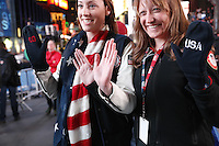 "NEW YORK - OCT 29: Team USA fans share a pair of ""Go USA"" Mittens. Olympic athletes participate in 100 Days to Sochi, a promotional event for the US Olympic Team, on Tuesday, October 29, 2013 in New York City. (Photo by Landon Nordeman)"