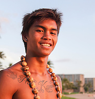 A cliff diver at the Sheraton Maui Resort and Spa smiles before the sunset show at Black Rock at Ka'anapali Beach, Maui.