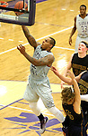 SIOUX FALLS, SD - JANUARY 2:  Charles Ward #22 from the University of Sioux Falls takes the ball to the basket against Augustana in the second half of their game Friday night at the Stewart Center. (Photo by Dave Eggen/Inertia)