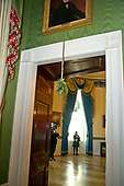 "The 2017 White House Christmas decorations, with the theme ""Time-Honored Traditions,"" which were personally selected by first lady Melania Trump, are previewed for the press in Washington, DC on Monday, November 27, 2017.  A papier-mâché mistletoe hangs over the doorway going from the Green Room into the Blue Room.<br /> Credit: Ron Sachs / CNP"