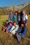 (L-R) Row 1. Matthew Adams Ansel&rsquo;s grandson, Sylvia Mayhew Desin, Ansel&rsquo;s granddaughter, Sarah Adams Ansel&rsquo;s granddaughter, Virginia Mayhew Ansel&rsquo;s granddaughter.  Row 2. Michael Adams Ansel&rsquo;s son, Anne Adams Helms Ansel&rsquo;s daughter, Ken Helms, Jeanne Adams. <br /> <br /> In August of 1987, the family and friends of Ansel Adams made a trip to Mount Ansel Adams to honor Ansel by putting his ashes on the mountain.  Leading the trip were Dr. Michael Adams and his wife, Jeanne, their son, Matthew, and daughter, Sarah.  Also in the group were Ansel&rsquo;s daughter, Anne Adams Helms, and her husband, Ken Helms, and Anne's daughters, Virginia (Ginny) Mayhew and Sylvia Mayhew Desin, and Sylvia&rsquo;s husband, Greg Desin.  Other members of the trip were Roger and Mitzi Hall, Matt Weston, Mrs. Desin (Greg&rsquo;s mother), and Billy Butler.  The Adams family invited me along with Leo Stutzin (Modesto Bee reporter) and my eldest son, Aaron Golub.  <br /> <br /> With some of us on horseback and others on foot, we began the hike at Tuolumne High Sierra Camp and headed to Vogelsang High Sierra Camp for the first night out.  The second day, we began by climbing through Vogelsang Pass, then descended by switchback down to Lewis Creek.  After climbing up from the creek we hiked by the Cony Crags before descending into the Lyell Fork of the Merced River ending up near Hutchings Creek at what is now referred to as the Ansel Adams Camp.  <br /> <br /> This camp was originally known generically as a Sierra Club Camp, but has more recently been referred to as Ansel Adams Camp because in 1934, Ansel led a Sierra Club outing to the Lyell Fork of the Merced River.  After the group climbed the then-unnamed peak that Adams called &ldquo;The Tower in Lyell Fork,&quot; they gathered around the campfire and agreed that the peak should bear Ansel&rsquo;s name.  The U.S. Geological Survey does not, however, permit naming features for living individuals, so the p