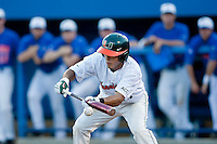 June 12, 2010:    Miami Infielder Stephen Perez (4) lays down a bunt during game two of NCAA Gainesville Super Regional action between the University of Florida Gators and Miami Hurricanes at Alfred A. McKethan Stadium on the campus of University of Florida in Gainesville.   Florida defeated Miami in 10 innings 4-3 to advance to the College World Series in Omaha, Nebraska...........