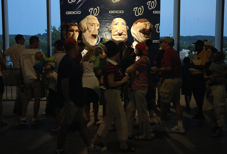 From left, Abe Lincoln, Thomas Jefferson, George Washington, and Teddy Roosevelt take pictures with fans after running the President's race in the middle of the fourth inning during the Nationals game at RFK stadium.