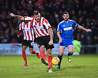 Lincoln City's Matt Rhead gets a shot on target under pressure from Notts County's Richard Duffy<br /> <br /> Photographer Andrew Vaughan/CameraSport<br /> <br /> The EFL Sky Bet League Two - Lincoln City v Notts County - Saturday 13th January 2018 - Sincil Bank - Lincoln<br /> <br /> World Copyright &copy; 2018 CameraSport. All rights reserved. 43 Linden Ave. Countesthorpe. Leicester. England. LE8 5PG - Tel: +44 (0) 116 277 4147 - admin@camerasport.com - www.camerasport.com