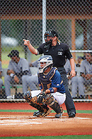 Umpire Jennifer Pawol and GCL Tigers East catcher Elys Escobar (22) during a game against the GCL Tigers West on August 4, 2016 at Tigertown in Lakeland, Florida.  GCL Tigers West defeated GCL Tigers East 7-3.  (Mike Janes/Four Seam Images)