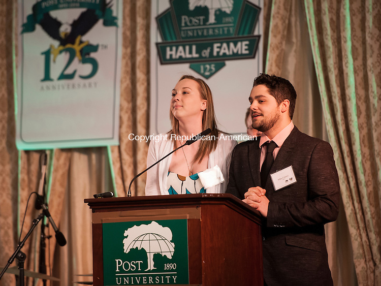 """PLANTSVILLE, CT-9 April 2015-040915EC01-  Post University students Emily Worth and Mike Colucci recite a poem called, """"Oh So Special"""" which highlights their positive thoughts about the school. Post's 125th anniversary event at the Aqua Turf Thursday night. The University inducted a dozen honorees into its Hall of Fame. Erin Covey Republican-American"""