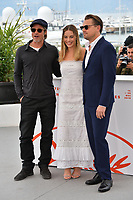 "CANNES, FRANCE. May 22, 2019: Brad Pitt, Margot Robbie & Leonardo DiCaprio at the photocall for ""Once Upon a Time in Hollywood"" at the 72nd Festival de Cannes.<br /> Picture: Paul Smith / Featureflash"